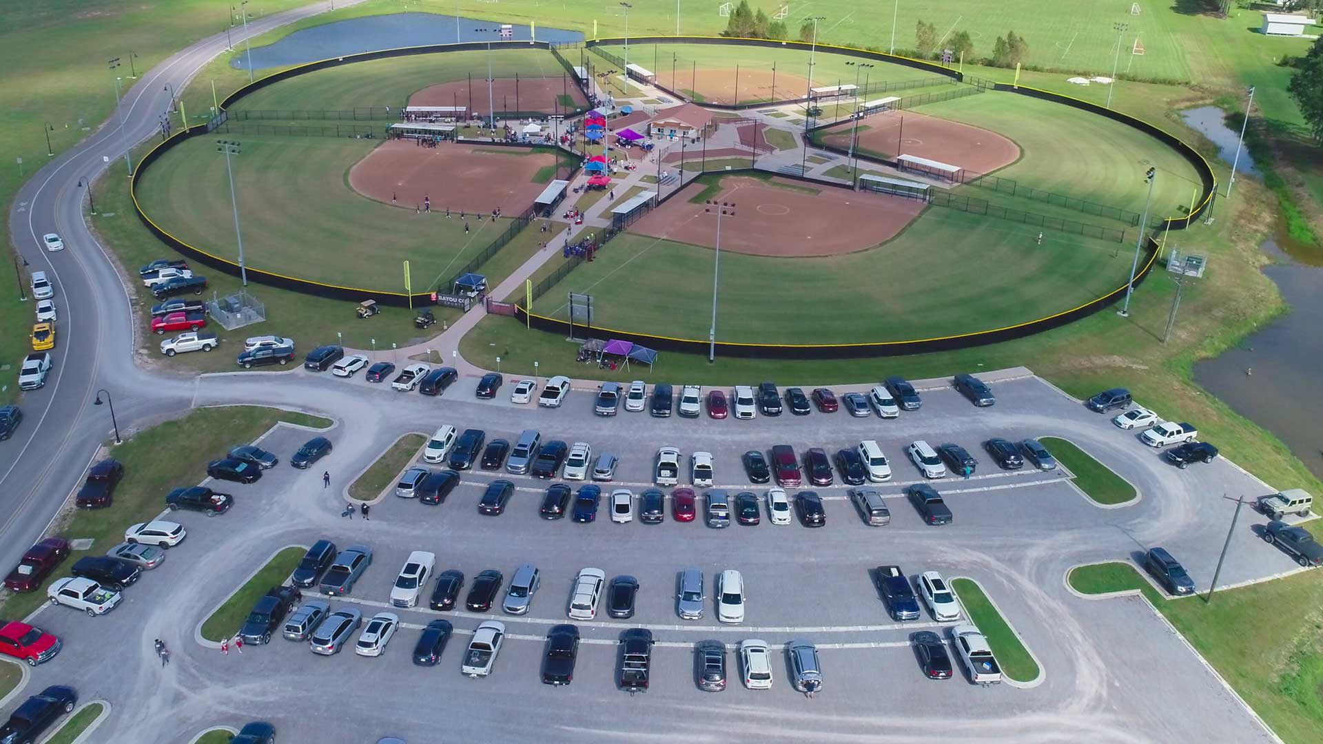 Photo of softball complex and parking lot.